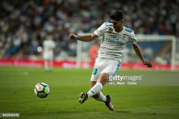 Marco Asensio of Real Madrid kicks toward the goal during the La Liga match between Real Madrid and Valencia CF at the Santiago Bernabéu Stadium on...