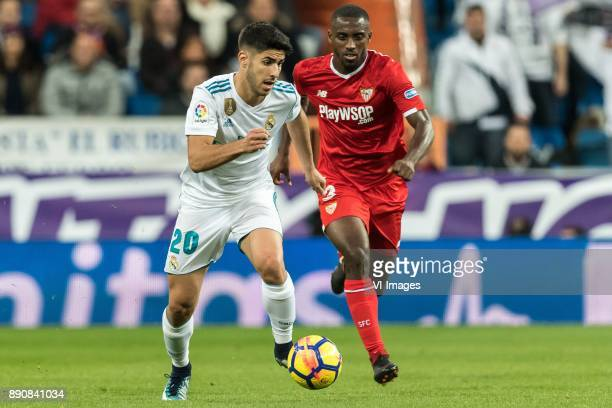 Marco Asensio of Real Madrid Lionel Jules Carole of Sevilla FC during the La Liga Santander match between Real Madrid CF and Sevilla FC on December...