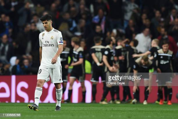 Marco Asensio of Real Madrid reacts as of Ajax players celebrate as Lasse Schone scores his team's fourth goal 1 during the UEFA Champions League...