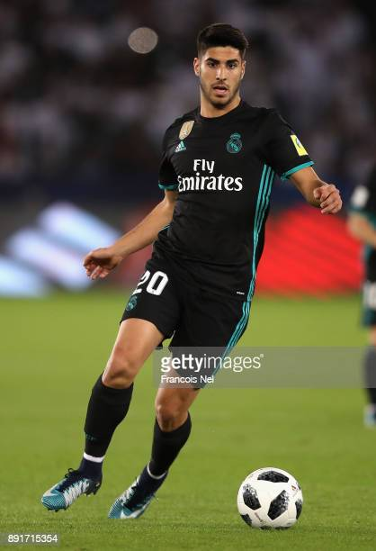 Marco Asensio of Real Madrid runs with the ball during the FIFA Club World Cup UAE 2017 semifinal match between Al Jazira and Real Madrid on December...