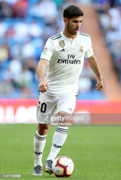 Marco Asensio of Real Madrid runs with the ball during the La Liga match between Real Madrid CF and Villarreal CF at Estadio Santiago Bernabeu on May...