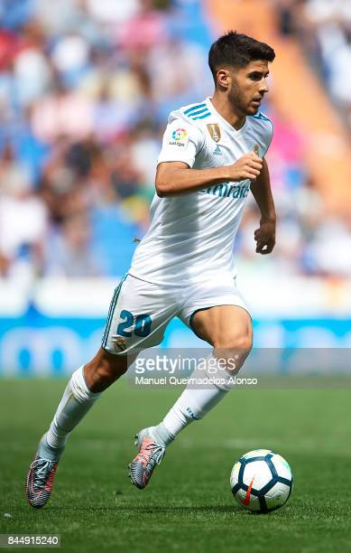 Marco Asensio of Real Madrid runs with the ball during the La Liga match between Real Madrid and Levante at Estadio Santiago Bernabeu on September 9...