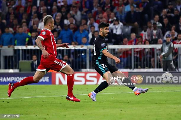 Marco Asensio of Real Madrid scores his sides second goal during the UEFA Champions League Semi Final First Leg match between Bayern Muenchen and...