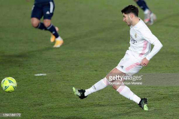 Marco Asensio of Real Madrid scores their team's second goal during the La Liga Santander match between Real Madrid and RC Celta at Estadio Santiago...