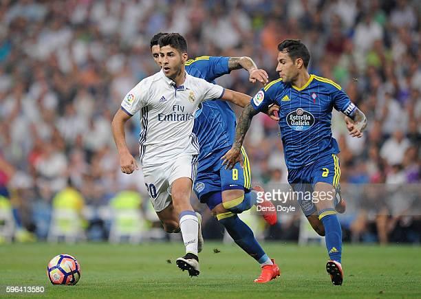 Marco Asensio of Real Madrid tries to shakes off Hugo Mallo of Celta de Vigo during the La Liga match between Real Madrid CF and RC Celta de Vigo at...