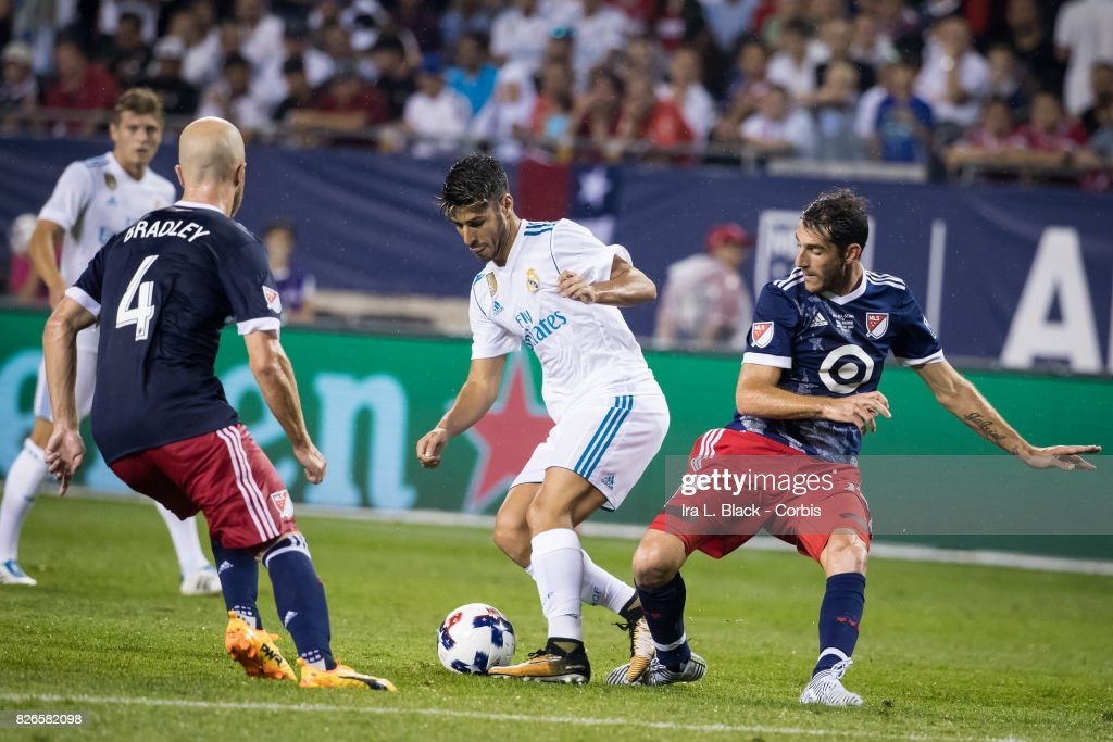 Marco Asensio #20 of Real Madrid tries to work around Michael Bradley #4 of MLS All-Stars and Ignacio Piatti #28 of MLS All-Stars during the MLS All-Star match between the MLS All-Stars and Real Madrid at the Soldier Field on August 02, 2017 in Chicago, IL. The match ended in a tie of 1 to 1. Real Madrid won the match on a 4 to 2 in penalty kicks.