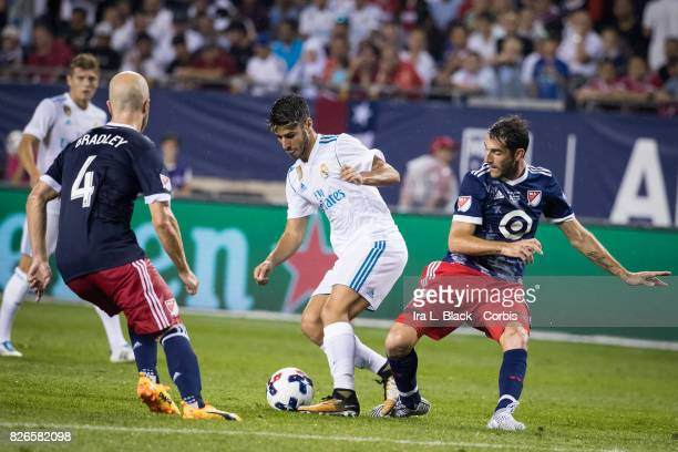 Marco Asensio of Real Madrid tries to work around Michael Bradley of MLS AllStars and Ignacio Piatti of MLS AllStars during the MLS AllStar match...
