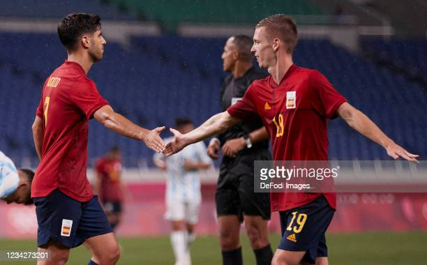 Marco Asensio of Spain and Dani Olmo of Spain high-five each other during the Men's Group C match between Spain and Argentina on day five of the...