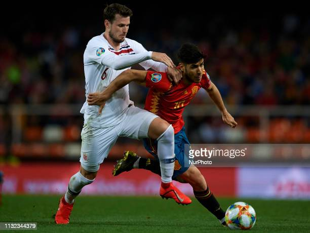 Marco Asensio of Spain and Havard Nordtveit of Norway battle for the ball during the 2020 UEFA European Championships group F qualifying match...