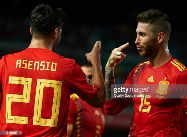 Marco Asensio of Spain celebrates after scoring his sides second goal with his teammate Sergio Ramos during the UEFA Nations League A group four...