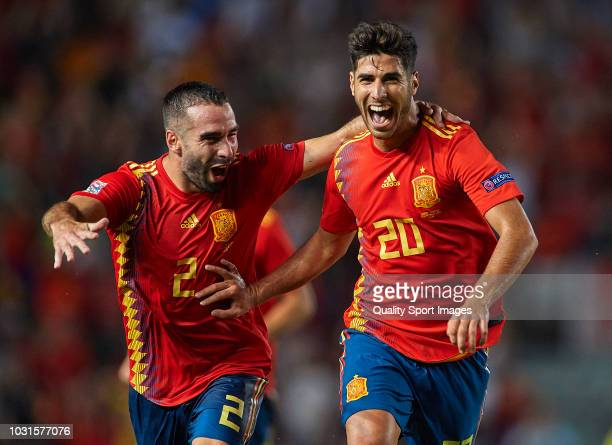 Marco Asensio of Spain celebrates after scoring his sides third goal with his teammate Dani Carvajal during the UEFA Nations League A group four...