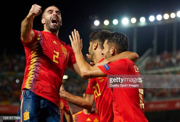 Marco Asensio of Spain celebrates after scoring his sides third goal with his teammates Dani Carvajal and Dani Ceballos during the UEFA Nations...