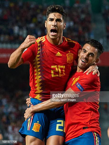 Marco Asensio of Spain celebrates after scoring his sides third with his teammate Dani Ceballos goal during the UEFA Nations League A group four...