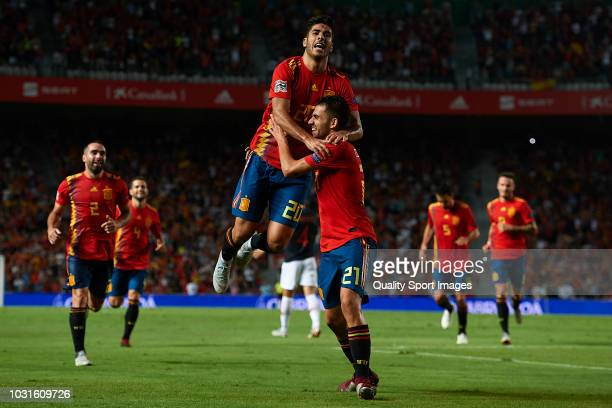 Marco Asensio of Spain celebrates after scoring his side's third with his teammate Dani Ceballos goal during the UEFA Nations League A group four...