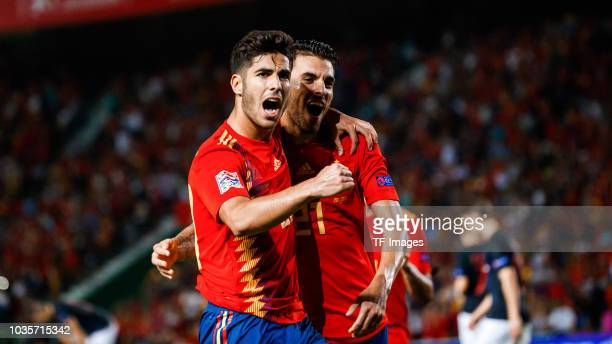 Marco Asensio of Spain celebrates after scoring his team`s third goal with Dani Ceballos of Spain during the UEFA Nations League A group four match...