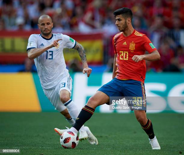 Marco Asensio of Spain competes for the ball with Fedor Kudriashov of Russia during the 2018 FIFA World Cup Russia Round of 16 match between Spain...