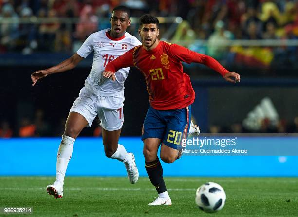 Marco Asensio of Spain competes for the ball with Gelson Fernandes of Switzerland during the International Friendly match between Spain and...