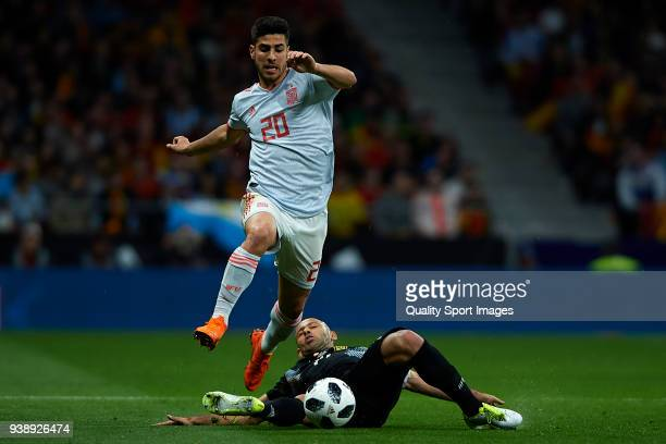 Marco Asensio of Spain competes for the ball with Javier Mascherano of Argentina during the International Friendly match between Spain and Argentina...