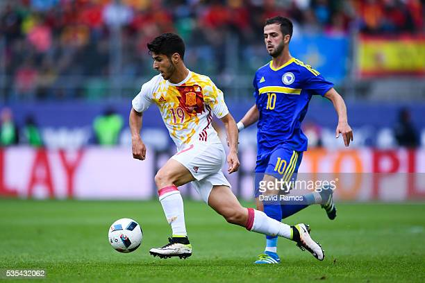 Marco Asensio of Spain competes for the ball with Miralem Pjanic of Bosnia during an international friendly match between Spain and Bosnia at the AFG...