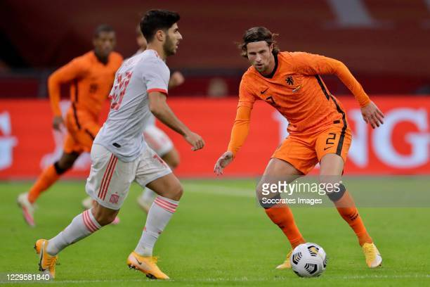 Marco Asensio of Spain, Hans Hateboer of Holland during the International Friendly match between Holland v Spain at the Johan Cruijff Arena on...