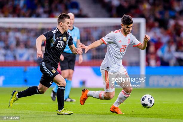 Marco Asensio of Spain in action against Giovani Lo Celso of Argentina during the International Friendly 2018 match between Spain and Argentina at...
