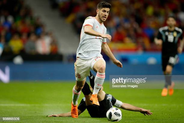 Marco Asensio of Spain Javier Mascherano of Argentina during the International Friendly match between Spain v Argentina at the Estadio Wanda...