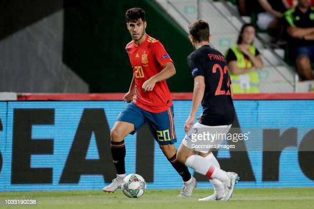 Marco Asensio of Spain Josip Pivaric of Croatia during the UEFA Nations league match between Spain v Croatia at the Estadio Manuel Martínez Valero on...