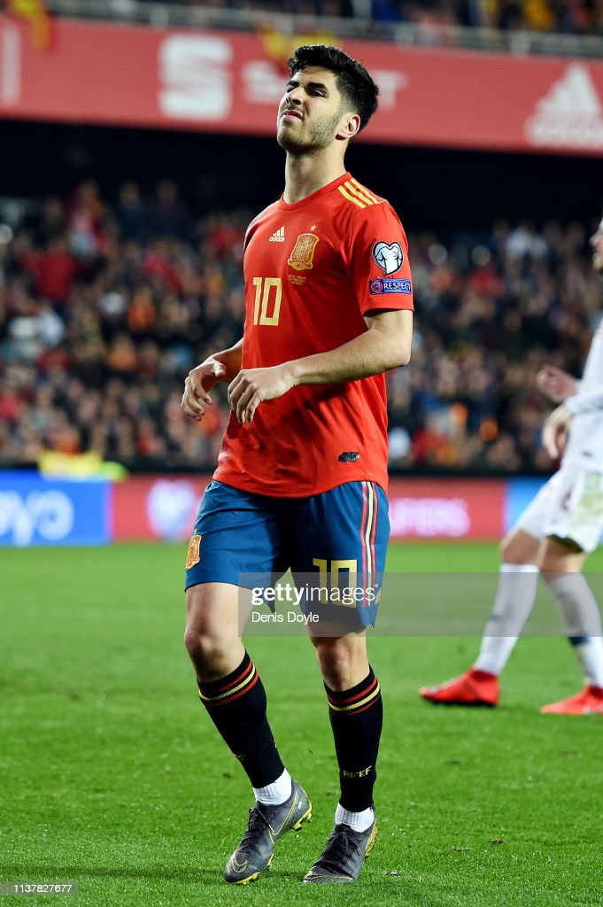 Marco Asensio of Spain reacts after attempting a chip ...