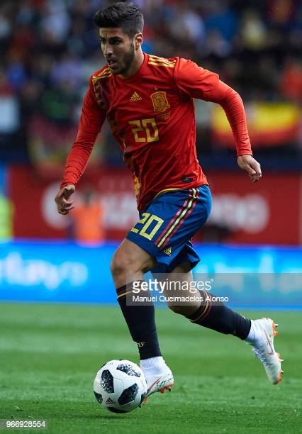 Marco Asensio of Spain runs with the ball during the International Friendly match between Spain and Switzerland at Estadio de La Ceramica on June 3...