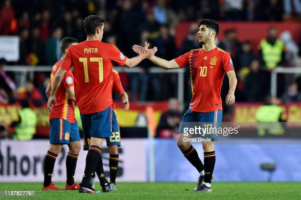 Marco Asensio of Spain shakes hands with teammate Jaime Mata after the 2020 UEFA European Championships group F qualifying match between Spain and...