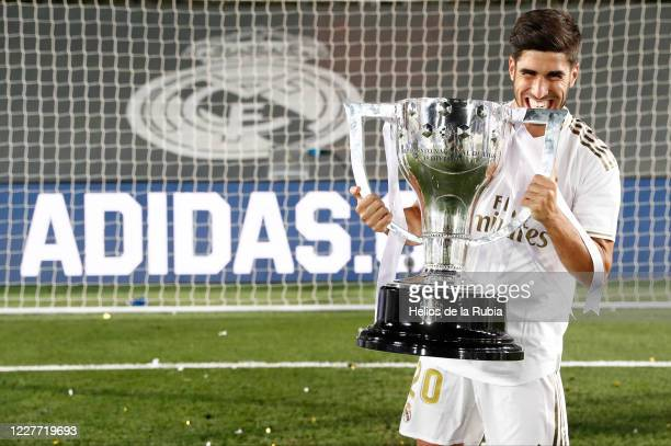 Marco Asensio players of Real Madrid poses with the La Liga trophy after Madrid secure the La Liga title during the Liga match between Real Madrid CF...