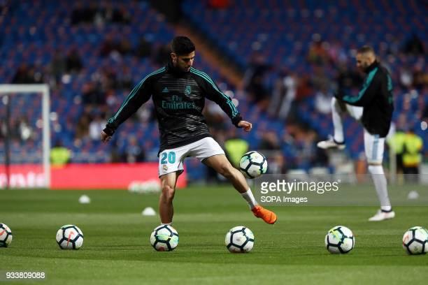 Marco Asensio warms up before the La Liga match between Real Madrid and Girona FC at Estadio Santiago Bernabéu. Final score .