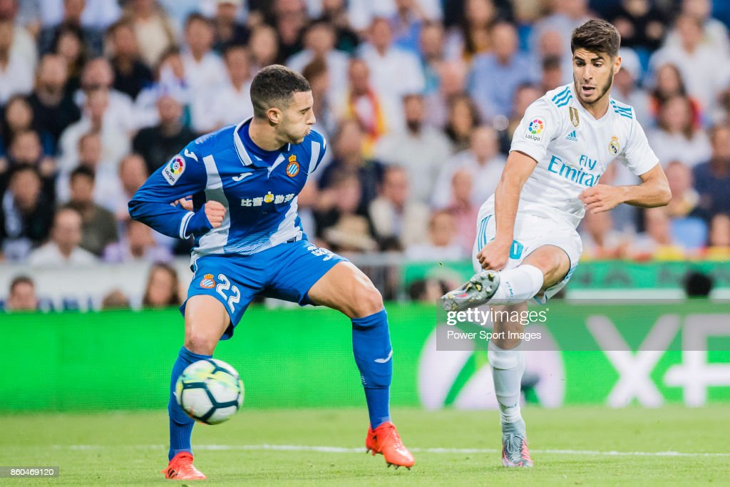 Marco Asensio Willemsen of Real Madrid (R) fights for the ball with Mario Hermoso Canseco of RCD Espanyol (L) during the La Liga 2017-18 match between Real Madrid and RCD Espanyol at Estadio Santiago Bernabeu on 01 October 2017 in Madrid, Spain.