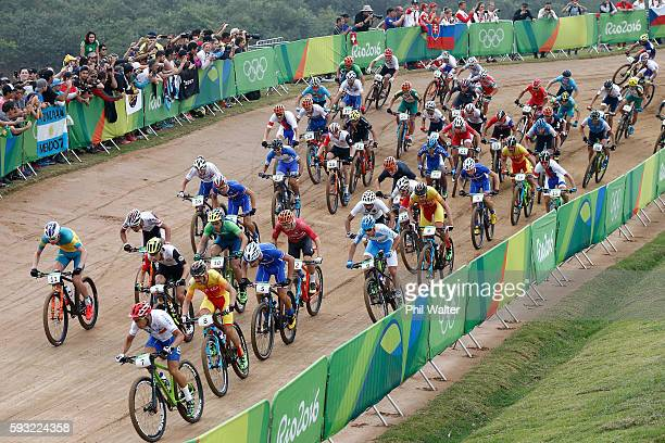 Marco Aurelio Fontana of Italy and Daniel McConnell of Australia lead a pack during the Men's CrossCountry on Day 16 of the Rio 2016 Olympic Games at...