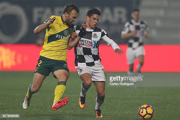 Marco Baixinho vies with Boavista's midfielder Renato Santos from Portugal during the match between FC Pacos de Ferreira and Boavista FC for the...
