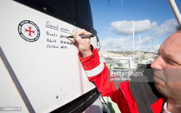 Marco Behns updates a tally counting the number of rescued refugees and the number of rescue missions on board the rescue cruiser Minden at the...