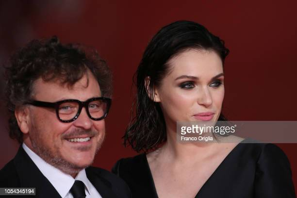 Marco Belardi and Caterina Shulha walk the red carpet ahead of the 'Notti Magiche' screening during the 13th Rome Film Fest at Auditorium Parco Della...