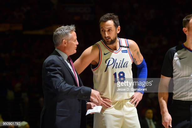 Marco Belinelli and Head Coach Brett Brown of the Philadelphia 76ers talk during the game against the Miami Heat in Game Five of Round One of the...