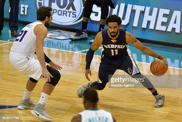 Marco Belinelli of Charlotte Hornets blocks Mike Conley of Memphis Grizzlies during the NBA match between Memphis Grizzlies vs Charlotte Hornets at...