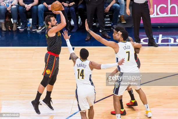 Marco Belinelli of the Atlanta Hawks attempts a threepoint basket against the Denver Nuggets at the Pepsi Center on January 10 2018 in Denver...