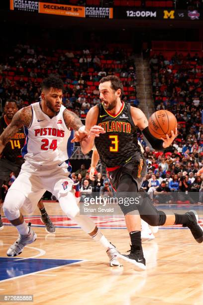 Marco Belinelli of the Atlanta Hawks handles the ball against Eric Moreland of the Detroit Pistons on November 10, 2017 at Little Caesars Arena in...