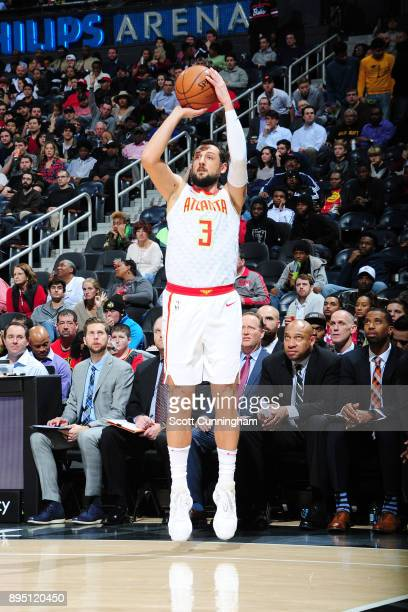 Marco Belinelli of the Atlanta Hawks shoots a 3pointer against the Miami Heat on December 18 2017 at Philips Arena in Atlanta Georgia NOTE TO USER...