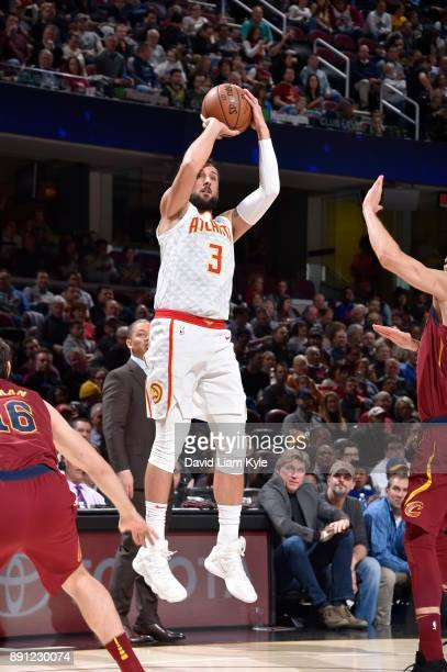Marco Belinelli of the Atlanta Hawks shoots the ball against the Cleveland Cavaliers on December 12 2017 at Quicken Loans Arena in Cleveland Ohio...