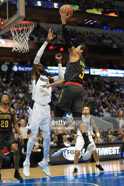 Marco Belinelli of the Atlanta Hawks takes a shot against the Dallas Mavericks in the first half at American Airlines Center on October 18 2017 in...