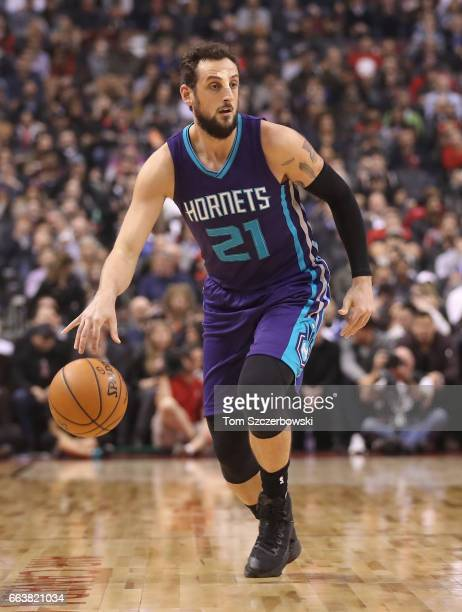 Marco Belinelli of the Charlotte Hornets dribbles against the Toronto Raptors during NBA game action at Air Canada Centre on March 29 2017 in Toronto...