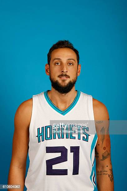Marco Belinelli of the Charlotte Hornets poses for a head shot during the 20162017 Charlotte Hornets Media Day at the Time Warner Cable Arena on...