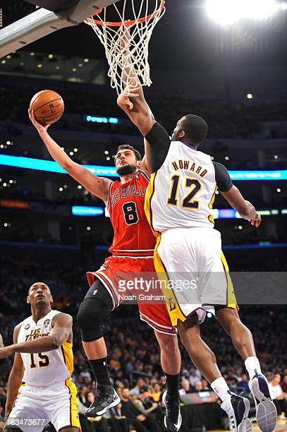 Marco Belinelli of the Chicago Bulls attempts a shot against Dwight Howard of the Los Angeles Lakers at Staples Center on March 10 2013 in Los...