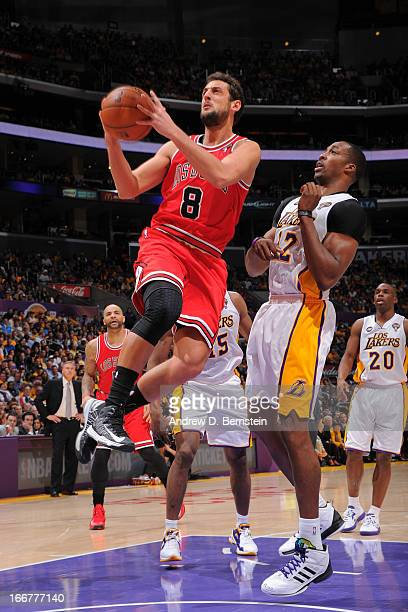 Marco Belinelli of the Chicago Bulls goes to the basket against Dwight Howard of the Los Angeles Lakers at Staples Center on March 10 2013 in Los...