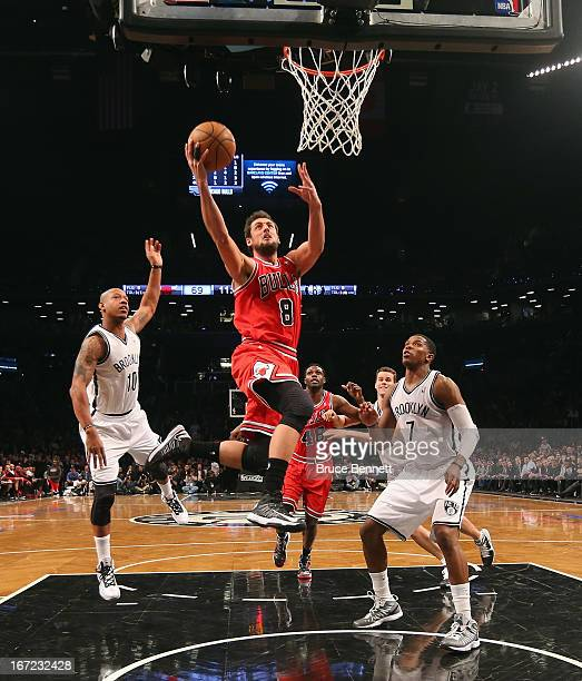 Marco Belinelli of the Chicago Bulls goes up and scores two against the Brooklyn Nets in the second half during Game Two of the Eastern Conference...
