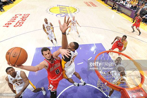 Marco Belinelli of the Chicago Bulls goes up for a shot against Dwight Howard of the Los Angeles Lakers at Staples Center on March 10 2013 in Los...